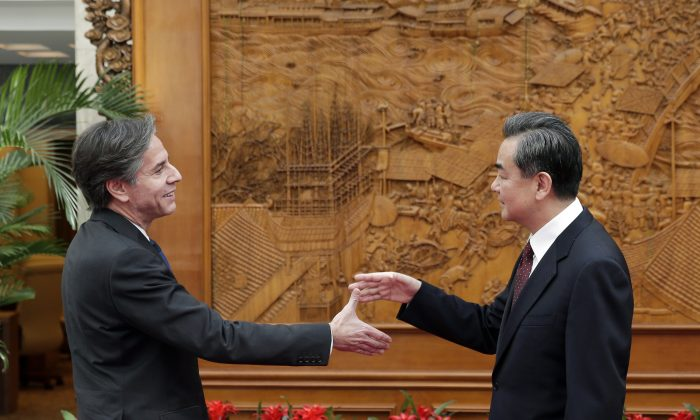 (L-R) U.S. Deputy Secretary of State Antony Blinken shakes hand with Chinese Foreign Minister Wang Yi at the Olive Hall before a meeting at the Foreign Ministry office in Beijing on Feb. 11, 2015. (Andy Wong - Pool/Getty Images)