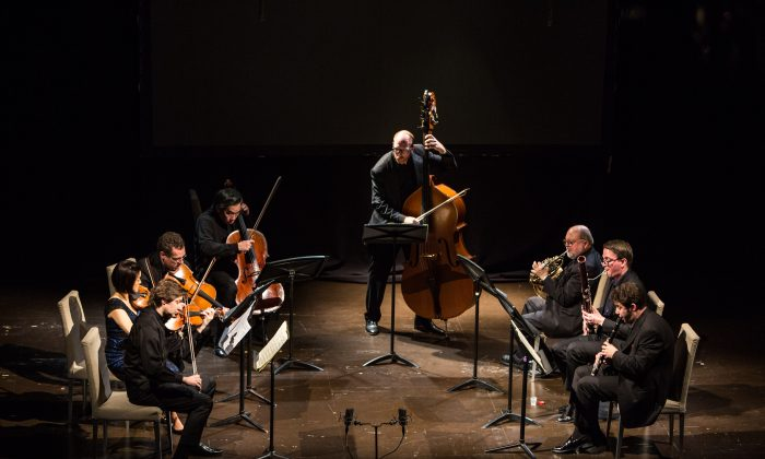 The Ying Quartet (L–R) Robin Scott on violin, Janet Ying on violin, Daniel Panner on viola, David Ying on cello, with Brendan Kane on double bass, Joesph Anderer on horn, William Short on bassoon, Alexander Bedenko on clarinet, play Schubert's Octet in F major, D803 at the Bohemian National Hall on Dec. 14, 2017. (Benjamin Chasteen/The Epoch Times)