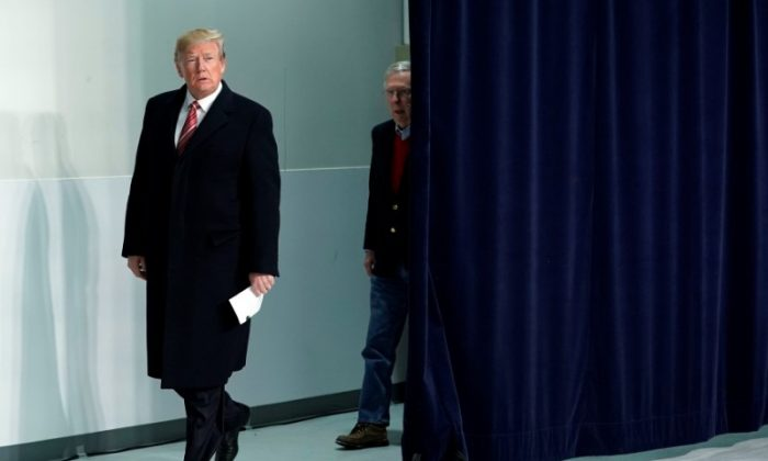 U.S. President Donald Trump arrives with Senate Majority Leader Mitch McConnell (R-KY) to speak to the media following the Congressional Republican Leadership retreat at Camp David, Maryland, U.S., Jan. 6, 2018. (Reuters/Yuri Gripas)