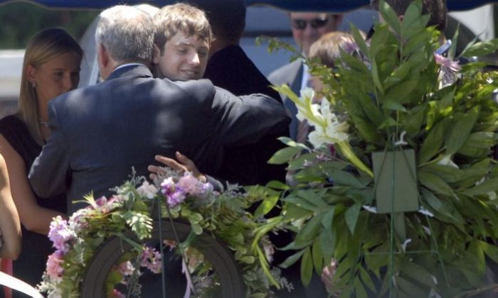 John Ramsey (L) hugs his son Burke at the grave of JonBenet Ramsey after graveside service for his wife Patsy Ramsey June 29, 2006 in Marietta, Georgia. Patsy Ramsey's daughter, JonBenet Ramsey, 6, was murdered under mysterious circumstances in the Ramsey's Boulder, Colorado house in December 1996. Patsy Ramsey died of ovarian cancer. (Barry Williams/Getty Images)