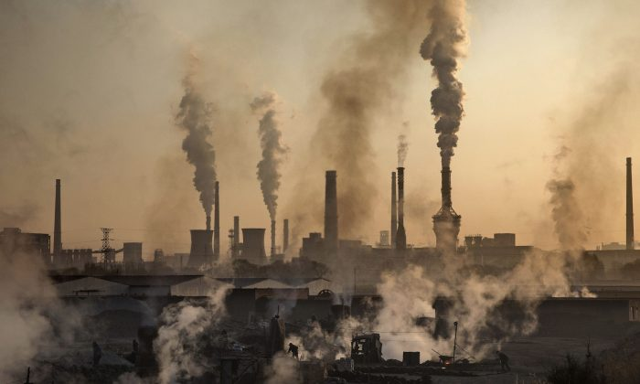 Smoke billows from a large steel plant in Inner Mongolia, China, on November 4, 2016. (Kevin Frayer/Getty Images)