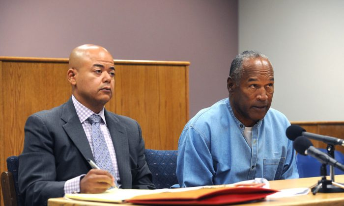 O.J. Simpson attends his parole hearing with his attorney Malcolm LaVergne at Lovelock Correctional Center in Lovelock, Nevada, July 20, 2017. (Jason Bean-Pool/Getty Images)
