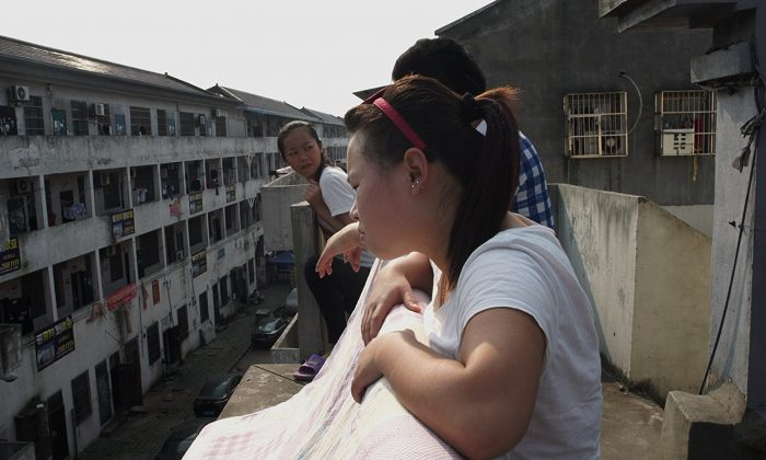 """A still shot from the fllm """"Bitter Money,"""" showing the dormitories that house migrant textile workers in China. (House on Fire)"""