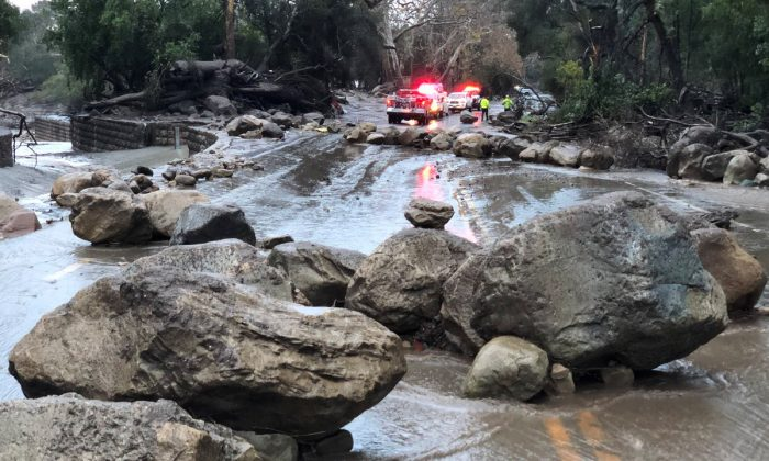 Boulders block a road after a mudslide in Montecito, California, U.S. in this photo provided by the Santa Barbara County Fire Department, Jan. 9, 2018. (Mike Eliason/Santa Barbara County Fire Department/Handout via Reuters)