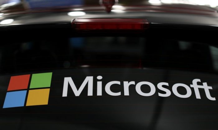 The Microsoft logo is shown on an electric car at the Auto Show in Los Angeles, California, U.S., November 28, 2017.      (Reuters/Mike Blake)