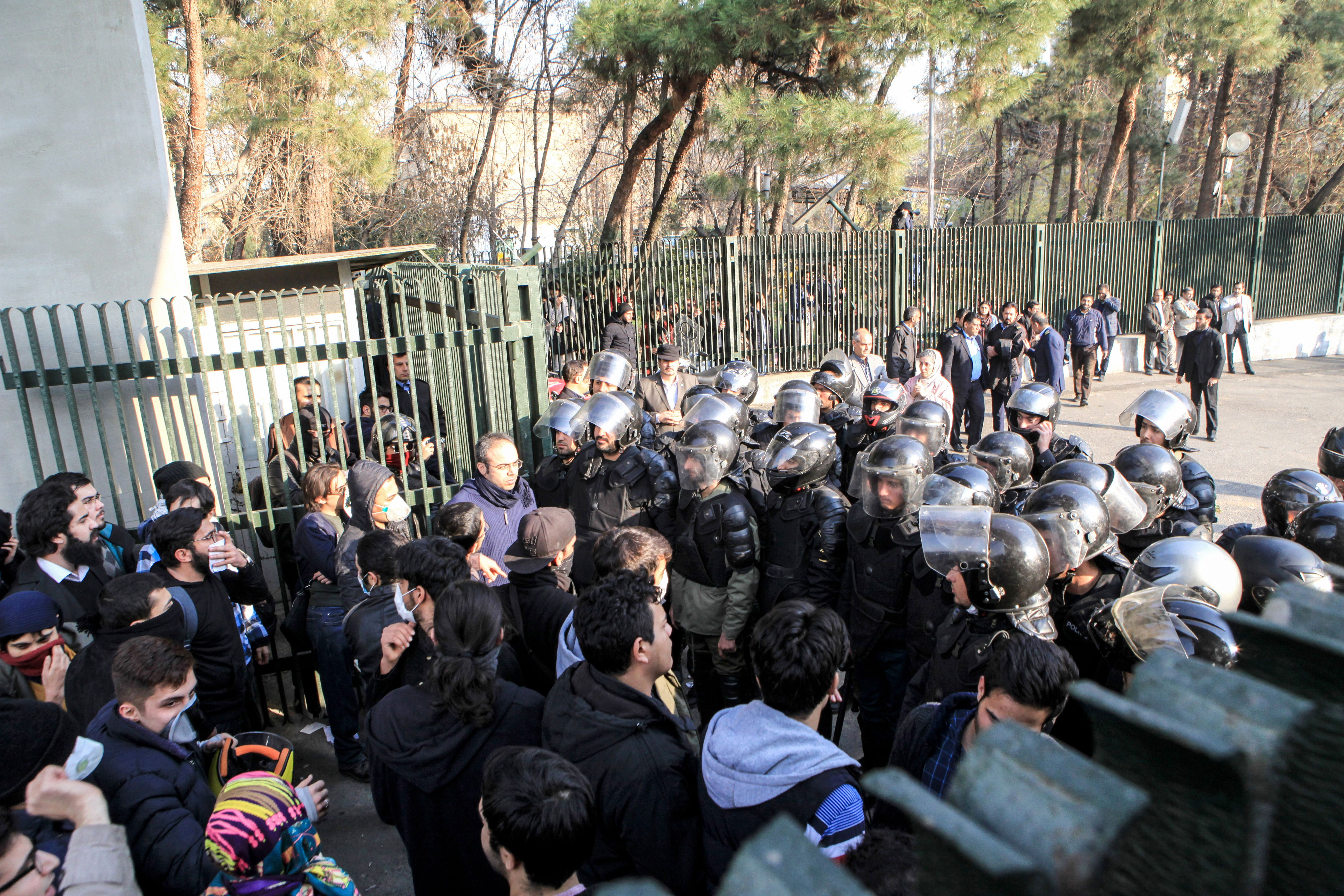 Students and police face off at the University of Tehran during a demonstration in Iran's capital Tehran on Dec. 30 2017