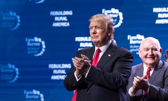 President Donald Trump and Secretary of Agriculture Sonny Perdue at the 99th annual American Farm Bureau Convention in Nashville, Tenn., on Jan. 8, 2018. (Samira Bouaou/The Epoch Times)