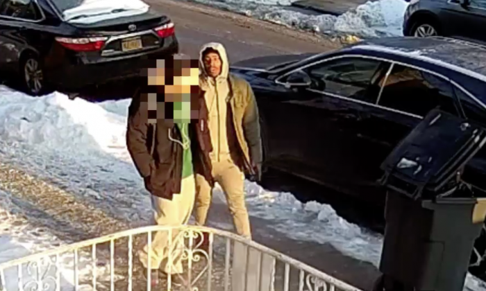 A screenshot from the surveillance footage shows the mugger approaching the 16-year-old. (Screenshot/NYPD)