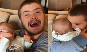 Man lets brother with Down Syndrome hold his newborn baby girl. But the reaction?—'I almost cried'