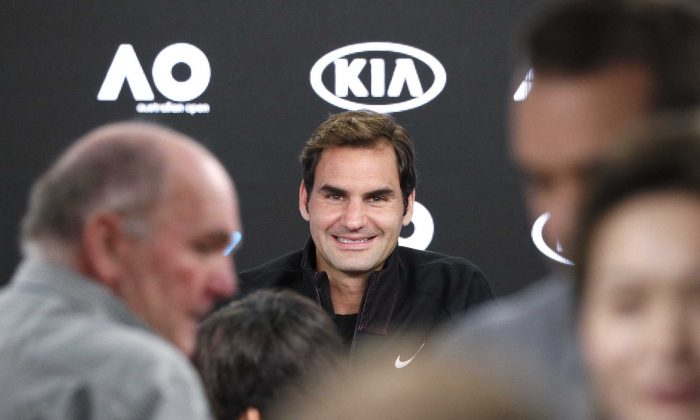 Roger Federer of Switzerland smiles during a news conference before the Australian Open tennis tournament, in Melbourne, January 14, 2018. (Reuters/Edgar Su)