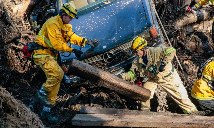 Rescue workers scour through cars for missing persons after a mudslide in Montecito. (Reuters/Kyle Grillot)