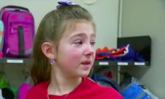 Girl reads book about heroes in class. But when she sees who walks in the door—she immediately jumps