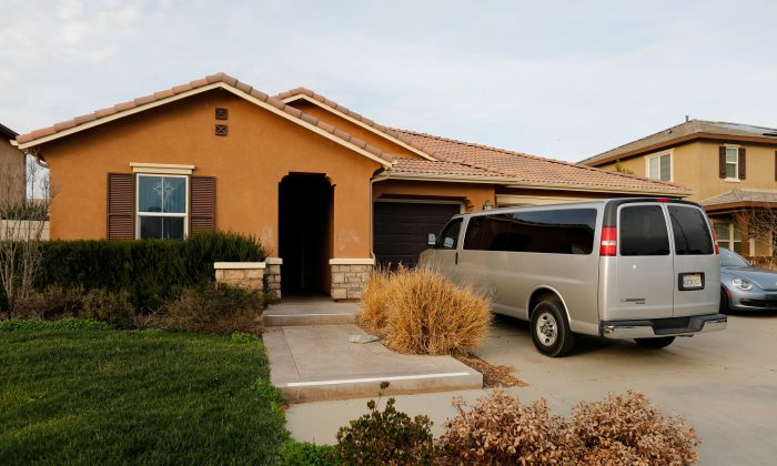 A van sits parked on the driveway of the home of David Allen Turpin and Louise Ann Turpin in Perris, California, on Jan. 15, 2018. (Reuters/Mike Blake)