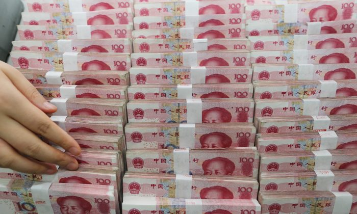 Yuan banknotes at a bank in Lianyungang, located in east China's Jiangsu Province on August 11, 2015. (STR/AFP/Getty Images)