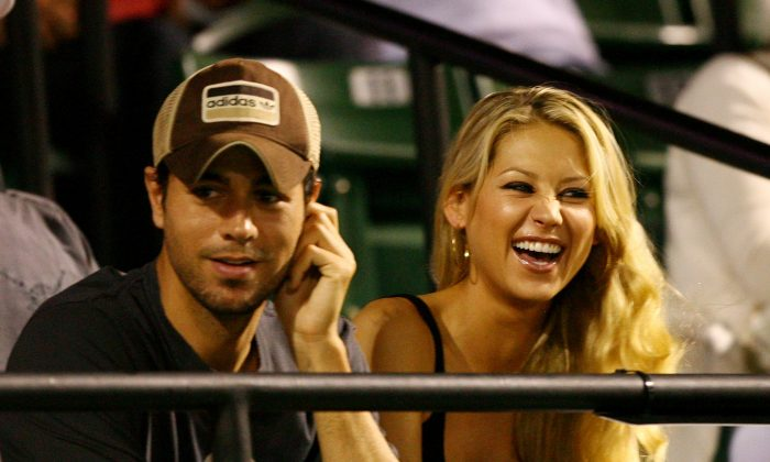 Enrique Iglesias and girlfriend Anna Kournikova watch as Venus Williams plays her semifinal match against Serena Williams at the Sony Ericsson Open at the Crandon Park Tennis Center on April 2, 2009, in Key Biscayne, Fla. (Al Bello/Getty Images)