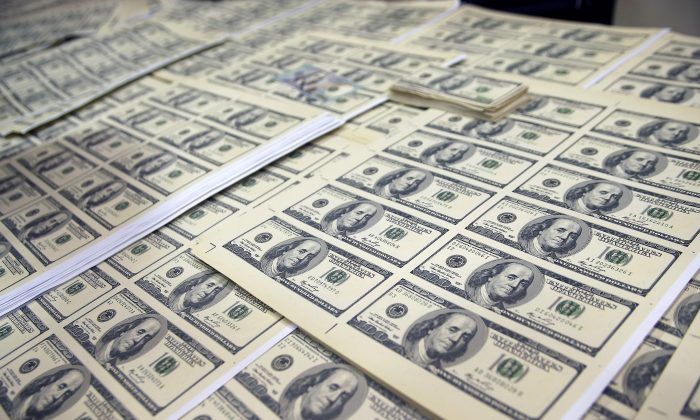 Sheets of counterfeit US dollar bills are displayed after a gang dedicated to forgery was dismantled in Lima, Peru on May 10, 2014. (AFP/Getty Images)