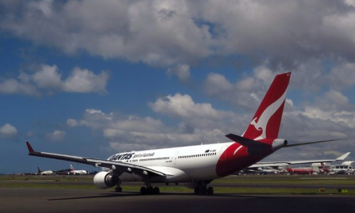 A Qantas Airways Airbus A330 aircraft can be seen on the tarmac near the domestic terminal at Sydney Airport in Australia, Nov. 30, 2017.  (Reuters/David Gray)