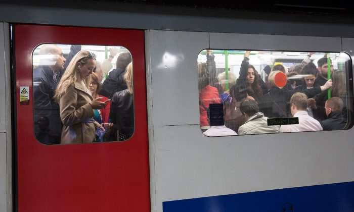 Commuters travel on the District Line of the London Underground, April 30, 2014 in London. (Oli Scarff/Getty Images)