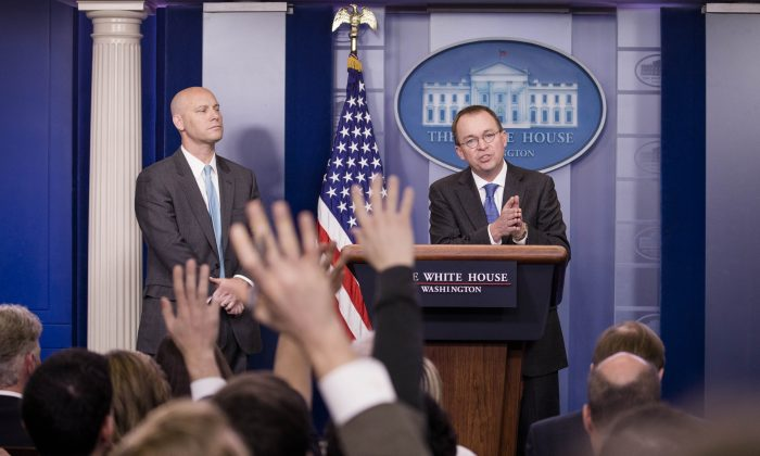 White House Director of Legislative Affairs Marc Short (L) and Director of the Office of Management and Budget Mick Mulvaney hold an emergency press conference at the White House in Washington, on Jan. 19, 2018. (Samira Bouaou/The Epoch Times)