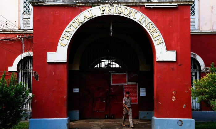 A security officer walks in front of Insein Prison in Yangon, Myanmar Dec. 29, 2017. (Reuters/Stringer)