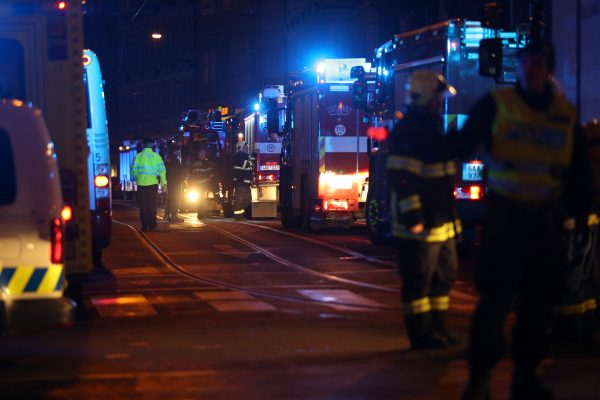 Firefighters work at the scene of a fire at a hotel in Prague Czech Republic