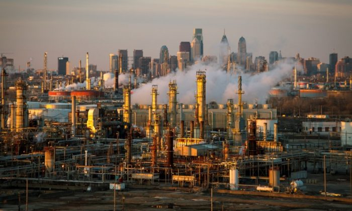 The Philadelphia Energy Solutions oil refinery owned by The Carlyle Group is seen at sunset in front of the Philadelphia skyline March 24, 2014.  (Reuters/David M. Parrott/File Photo)