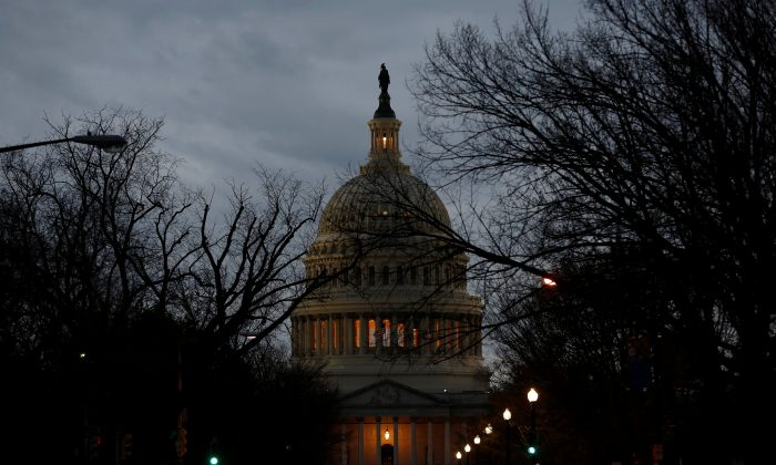 The U.S. Capitol is lit during the second day of a shutdown of the federal government in Washington, U.S., Jan. 21, 2018. (Reuters/Joshua Roberts)