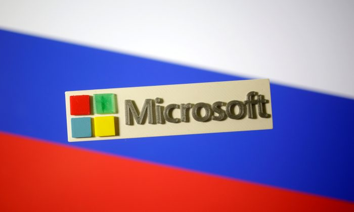 A 3D-printed Microsoft logo is seen on a displayed Russian flag in this illustration taken Jan. 12, 2018. (Reuters/Dado Ruvic/Illustration)