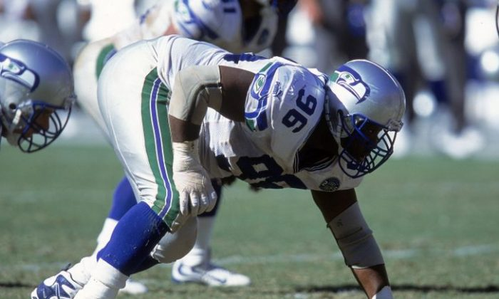 Cortez Kennedy #96 of the Seattle Seahawks gets ready to move at the hike during the game against the San Diego Chargers at Qualcomm Stadium in San Diego, California.  (Getty Images)
