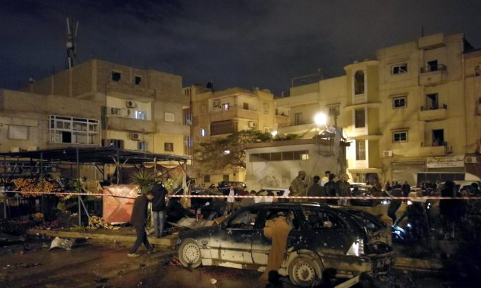 People gather at the site of twin car bombs in Benghazi, Libya, Jan. 23, 2018. (Reuters/Stringer)