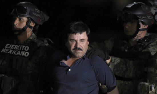 "Drug kingpin Joaquin ""El Chapo"" Guzman is escorted into a helicopter at Mexico City's airport on Jan. 8, 2016. (ALFREDO ESTRELLA/AFP/Getty Images)"