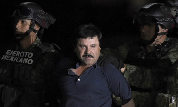 "Drug kingpin Joaquin ""El Chapo"" Guzman is escorted into a helicopter at Mexico City's airport on Jan. 8, 2016. (ALFREDO ESTRELLA/AFP/Getty Images)"