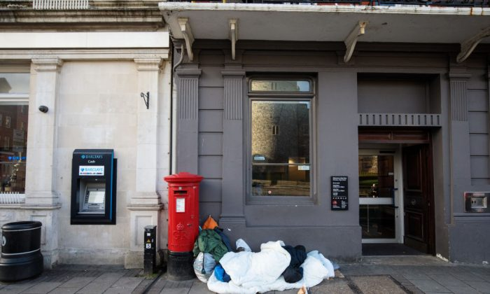 In this file photo a person (not featured in the story) sleeps rough in front of a bank on Jan. 5, 2018 in Windsor, England. (Jack Taylor/Getty Images)