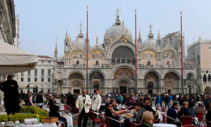 Tourists dining outside San Marco Cathedral in Venice on Oct. 20, 2017. (Miguel Medina/AFP/Getty Images)