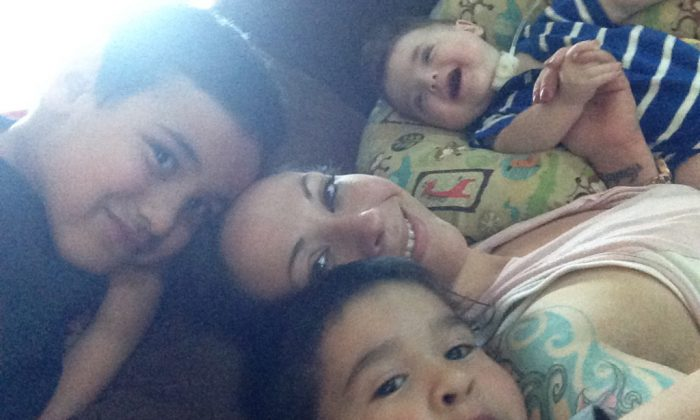 Michelle Leavy and her three sons, ages 7, 5, and 3. She became addicted to opioids when she was discharged from the hospital with doctors' advice to treat her post-c-section pain with opioids. She is now in recovery. (Courtesy of Michelle Leavy)
