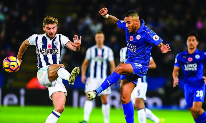 The team West Bromwich Albion (L), which is being sponsored by K8.com, an online casino company, plays against Leicester City during a Premier League match in Leicester, England, on Nov. 6, 2016. (MICHAEL REGAN/GETTY IMAGES)