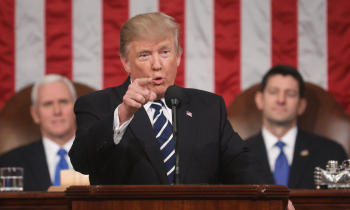 President Donald J. Trump delivers his first address to a joint session of Congress from the floor of the House of on Feb. 28, 2017. On Jan. 30, 2018, Trump will deliver his first State of the Union address. (JIM LO SCALZO/AFP/Getty Images)