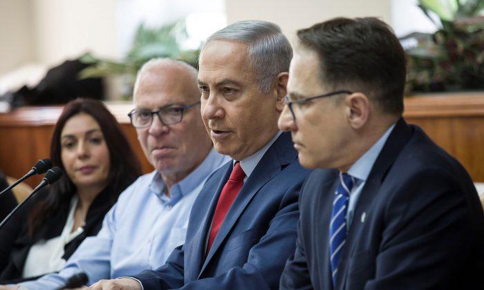 Israeli Prime Minister Benjamin Netanyahu (2nd R) sits next to Cabinet Secretary Tzachi Braverman (R), Israeli Agriculture Minister Uri Ariel (2nd L) and Israeli Culture Minister Miri Regev (L) during the weekly cabinet meeting at the Prime Minister's office in Jerusalem Jan. 28, 2018. (Reuters/Tsafrir Abayov/Pool)