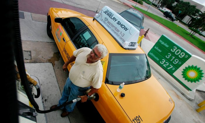 A taxi driver in Miami in a file photo on July 18, 2006. (Photo by Joe Raedle/Getty Images)