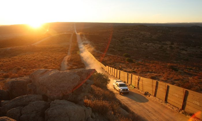 Border Patrol agents patrol the US-Mexico border fence near the rural town of Campo, some 60 miles east of San Diego, Calif., on July 30, 2009. On Jan.  25, a DACA recipient was arrest nearby on human smuggling charges. (David McNew/Getty Images)
