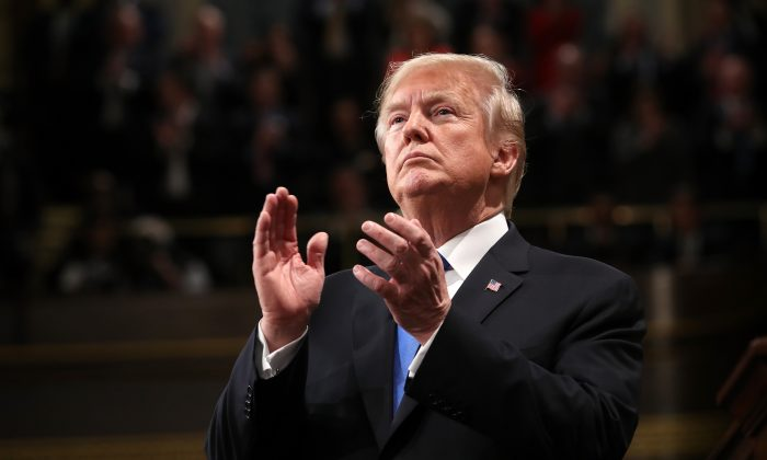President Donald J. Trump claps during the State of the Union address in the chamber of the U.S. House of Representatives in Washington on Jan. 30, 2018. (Win McNamee/Getty Images)