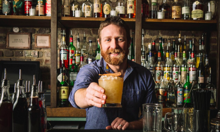 Is mixologist Mike Di Tota holding a cocktail or a non-alcoholic drink? Only he and the drinker know. (Sam Ortiz)