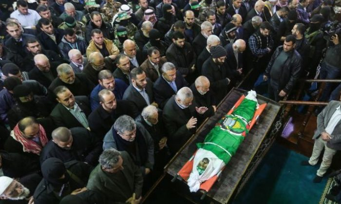 Palestinian mourners pray over the body of Hamas senior leader Imad al-Alami during his funeral at the al-Omari mosque in Gaza City on Jan. 30, 2018.