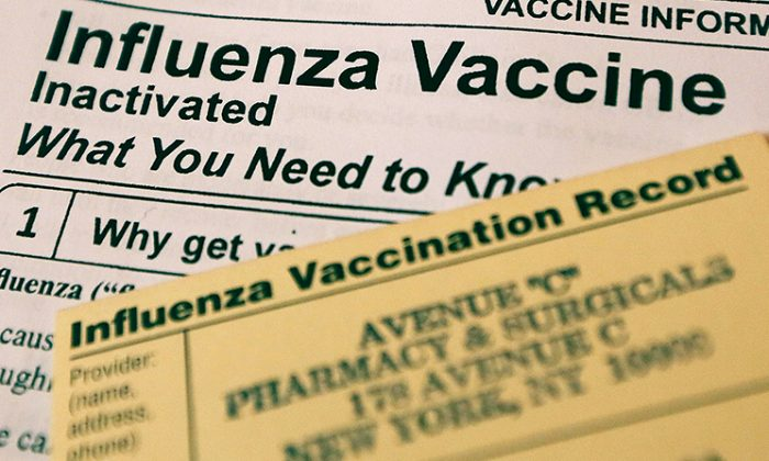 This photo illustration shows Influenza vaccine paperwork for patients. (Mario Tama/Getty Images)