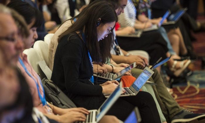Chinese journalists work on their computers during the G20 meeting in Chengdu, in western China's Sichuan Province on July 23, 2016. Observers say that the digitalization of journalism and the emergence of social media have done little to increase press freedom in China, as Chinese regime rapidly moved to impose censorship on new platforms. (Fred Dufour/AFP/Getty Images)