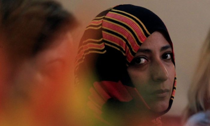 Nobel Peace Prize winner Tawakkol Karman of Yemen looks on during a news conference as part of the Nobel Women's Initiative to gather a first-hand account of the ongoing violence against women land defenders, in Tegucigalpa, Honduras, October 24, 2017. (Reuters/Jorge Cabrera)