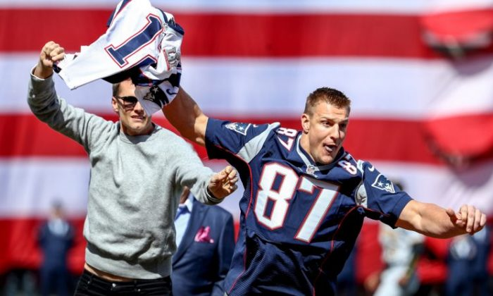 Rob Gronkowski of the New England Patriots steals Tom Brady's jersey before the opening day game between the Boston Red Sox and the Pittsburgh Pirates at Fenway Park in Boston, Massachusetts on April 3, 2017. (Photo by Maddie Meyer/Getty Images)