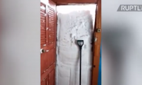 Man Tries to Break Free From Home Blocked by Solid Wall of Snow