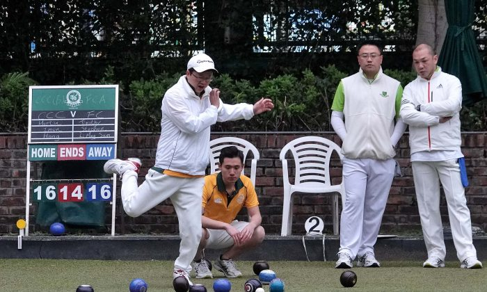 Imen Tang of Craigengower Cricket Club jumped in anxiety as the bowl from his skipper Lui Chin Hong (Not in photo) narrowly missed the target and lost four shots in this end. Eventually Lui lost the game 17:20 but CCC still finished with a 6-2 overall victory. (Mike Worth)