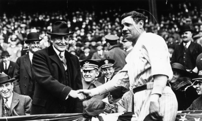 Great all-round baseball player, Babe Ruth (George Herman Ruth, 1895 - 1948) shakes hands with the 29th President of the USA, Warren Harding. After the handshake Babe Ruth hit a home run to help his team, the New York Yankees win the third game of the series with the Wash. (Keystone/Getty Images)